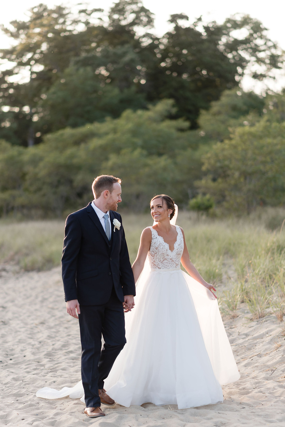 wedding photo on beach behind Tupper Manor during sunset