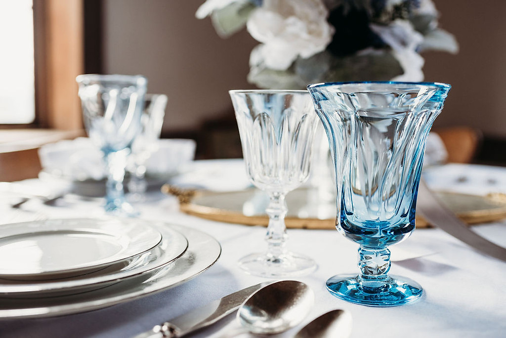 table scape with dishes at wedding with china