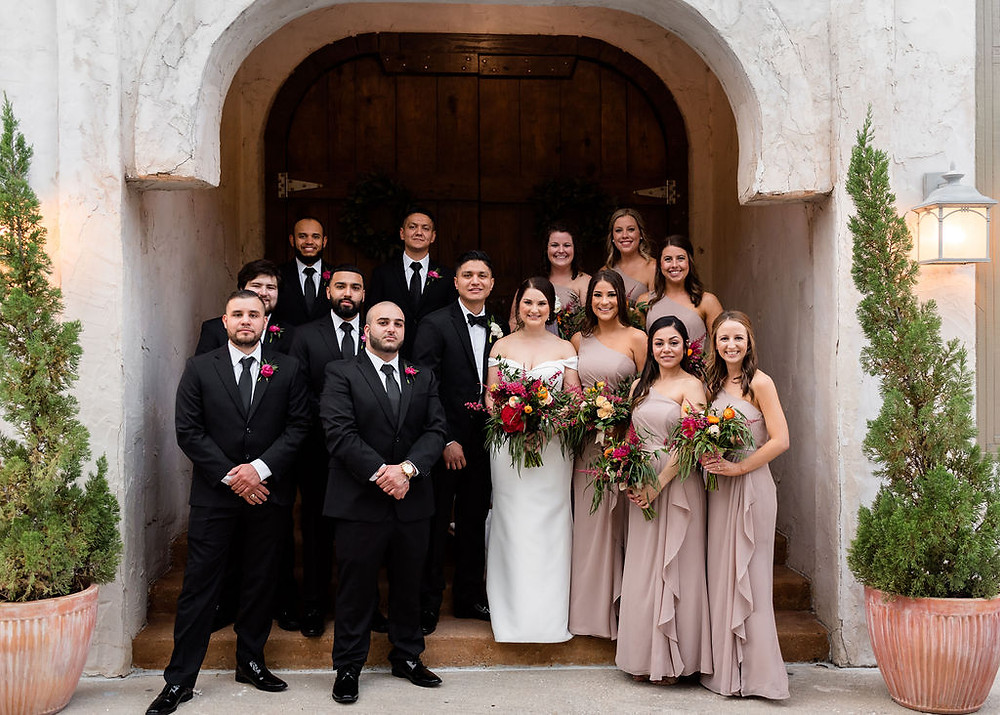 wedding party photo on steps of chapel at villa antonia