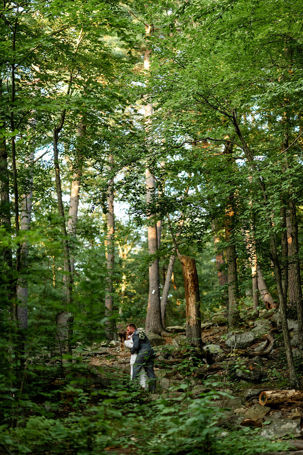 bride and groom walking through the woods during their Massachusetts elopement