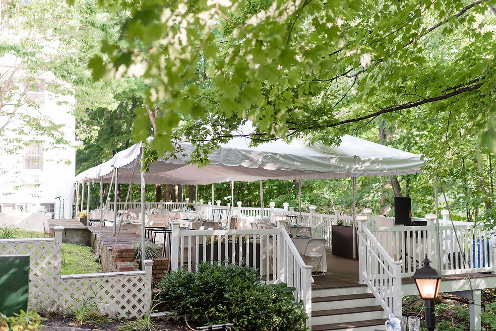 tented reception on back deck of chocksett inn
