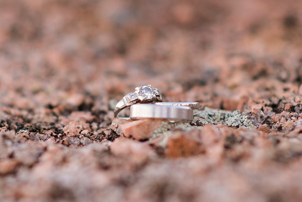 macro photo of wedding rings on pink granite at enchanted rock