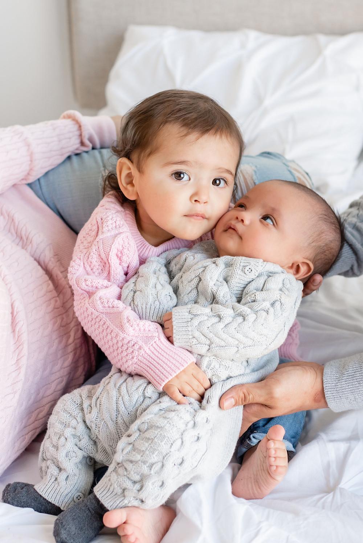 toddler and newborn baby pose