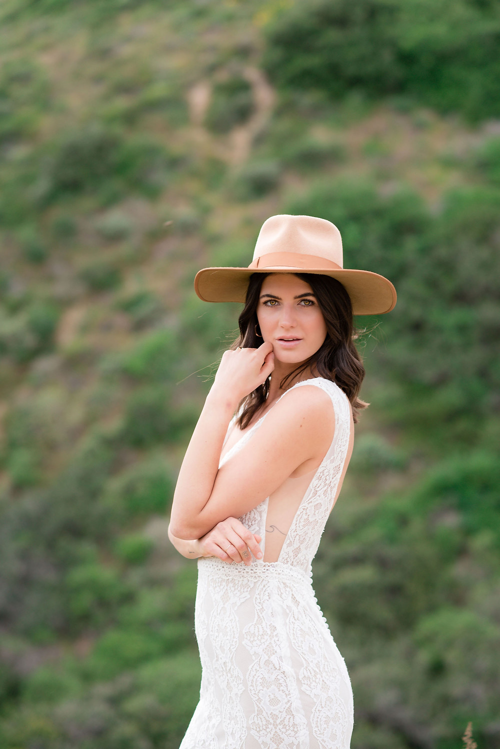 bride wearing stylish hat