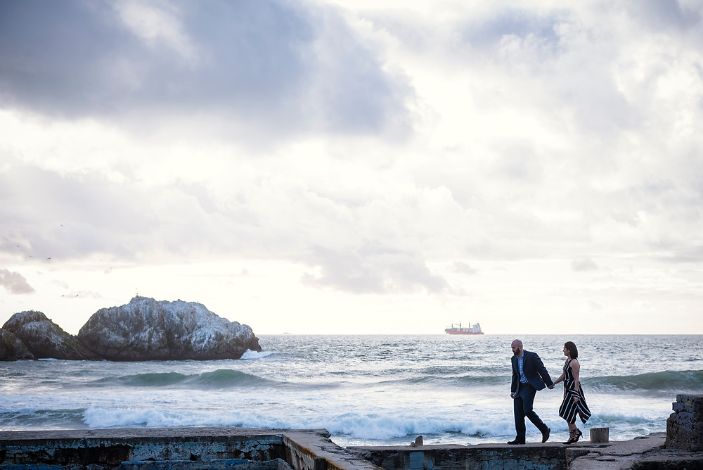 couple walking on ledge at Land's End in San Fransisco