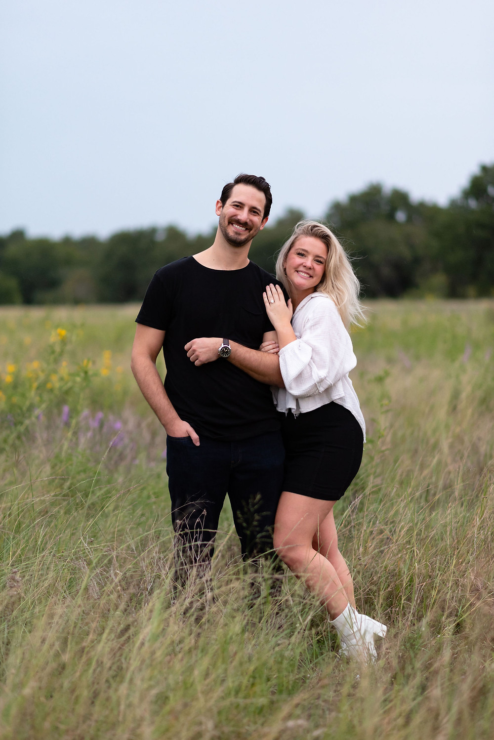 couple poses looking at the camera after just getting engaged