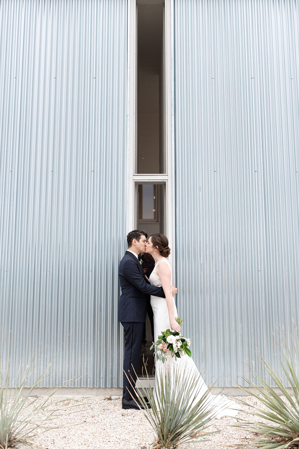 bride and groom photo outside of industrial wedding venue