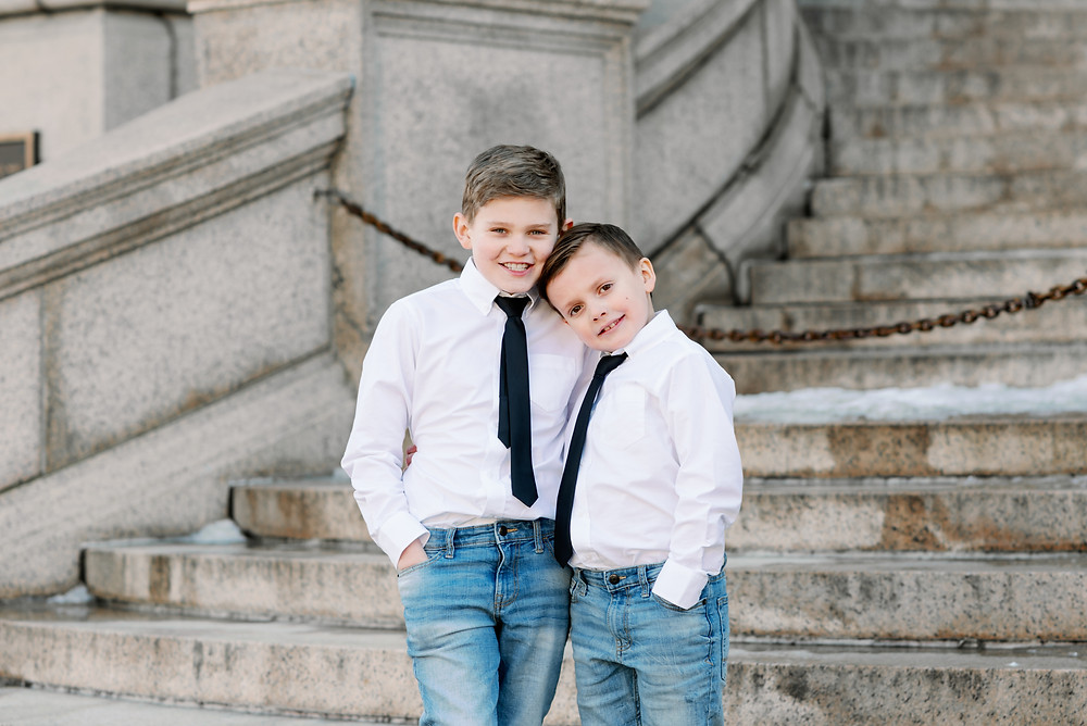 bride's sons posing on stairs