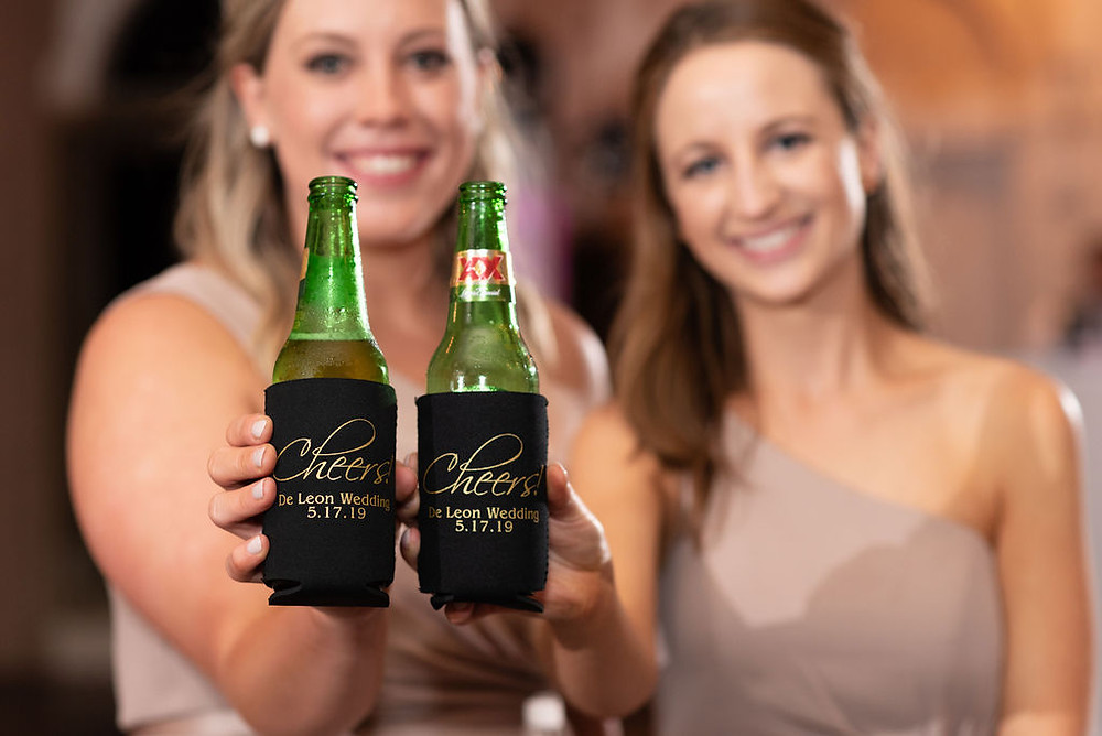 bridesmaids holding up personalized koozies