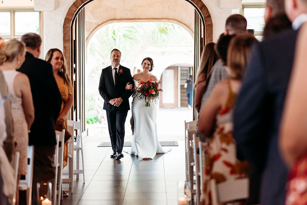 bride and dad enter chapel and walk down aisle for wedding ceremony at villa antonia