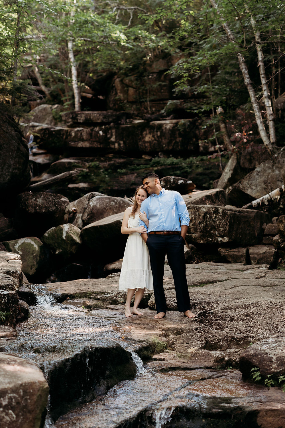 bride and groom by Champney falls during the mount chocorua hike for their elopement. New Hampshire elopement photographer