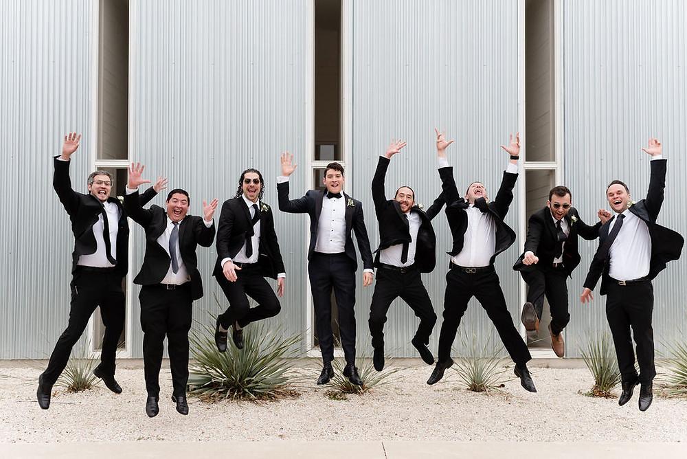 fun groomsmen photo. all groomsmen jump at the same time