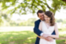 candid portrait of bride and groom after wedding ceremony at sanctury event space in austin texas at butle park under oak trees