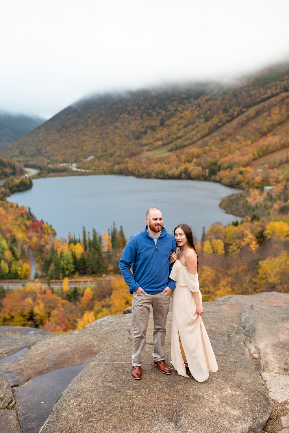 couple posing for photo at artists bluff. girl is wearing AW Bridal dress