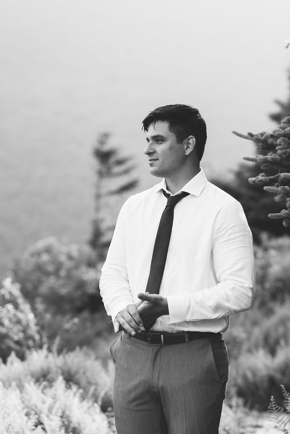 moody black and white grooms portrait
