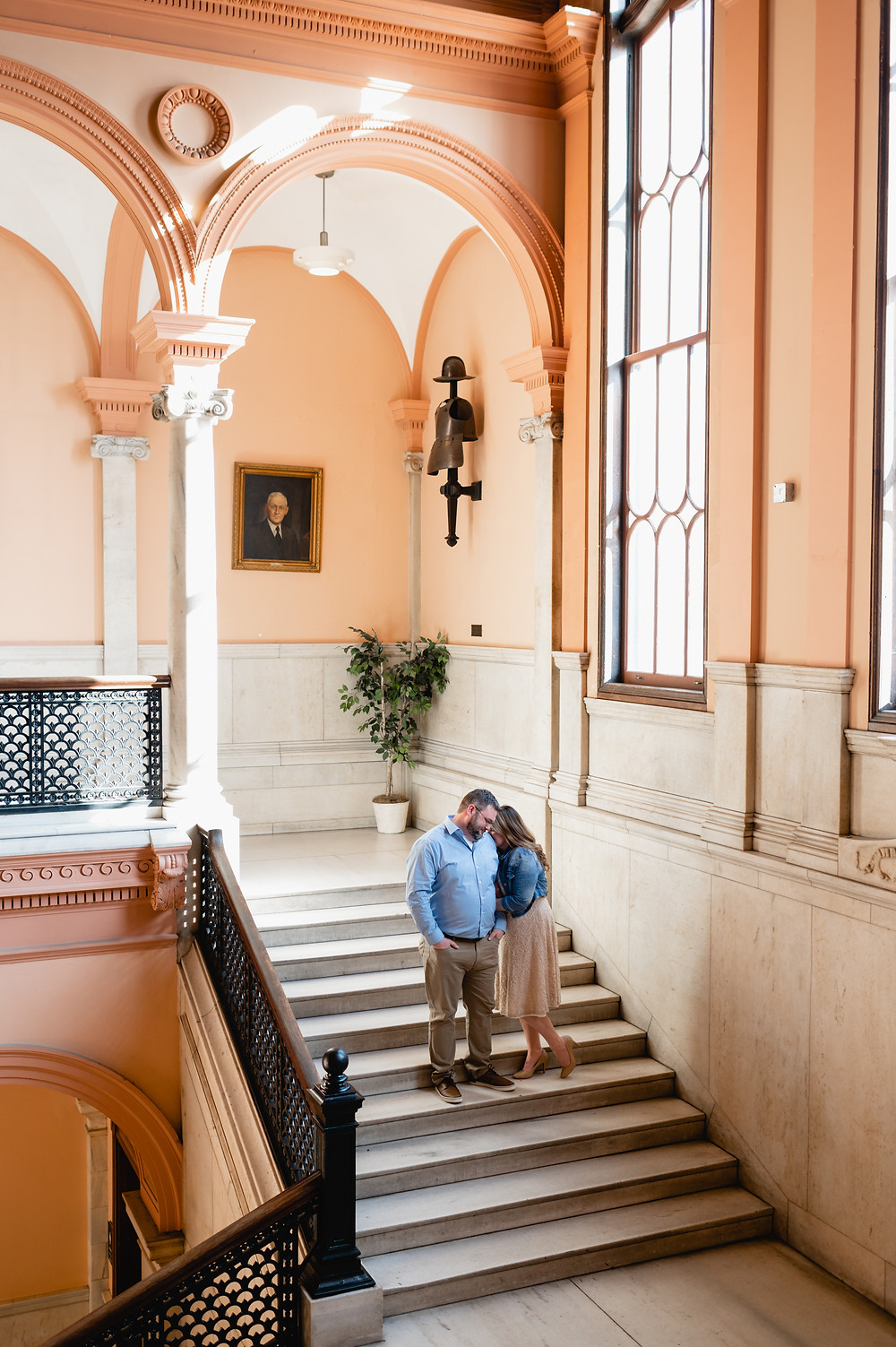 worcester city hall architecture with couple posing on stairs for elopement