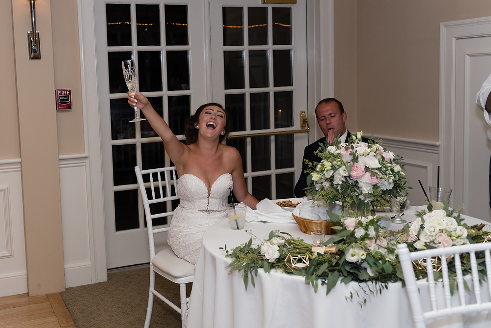 couple's reactions during toasts at wedding at brookside country club