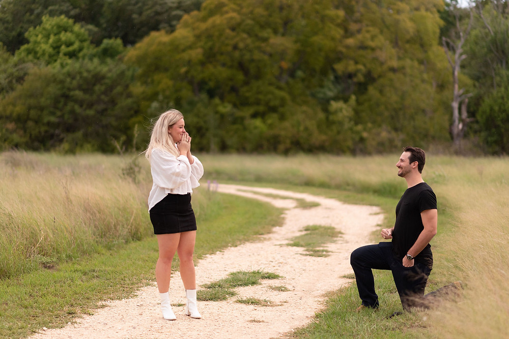 guy down on one knee, about to propose