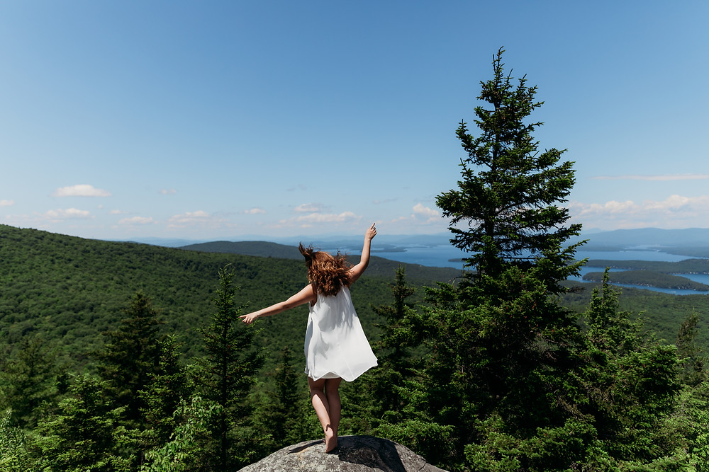 girl in a white dress on top of a mountain in New Hampshire