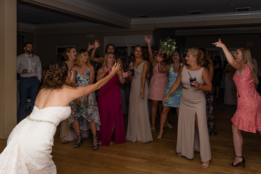 bouquet toss at wedding at brookside country club