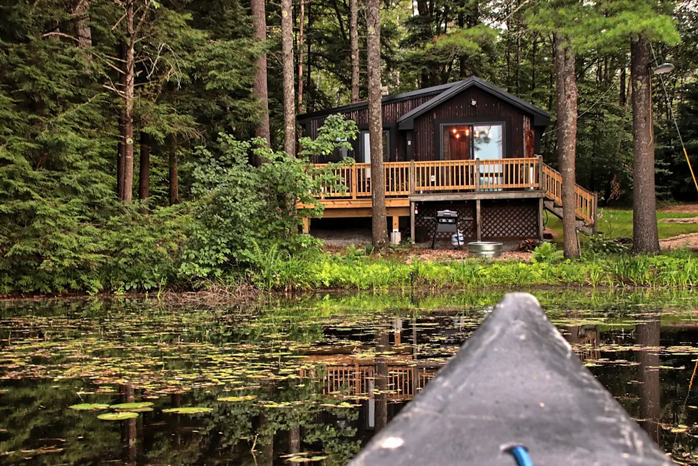 retreat in this waterfront cabin with a canoe