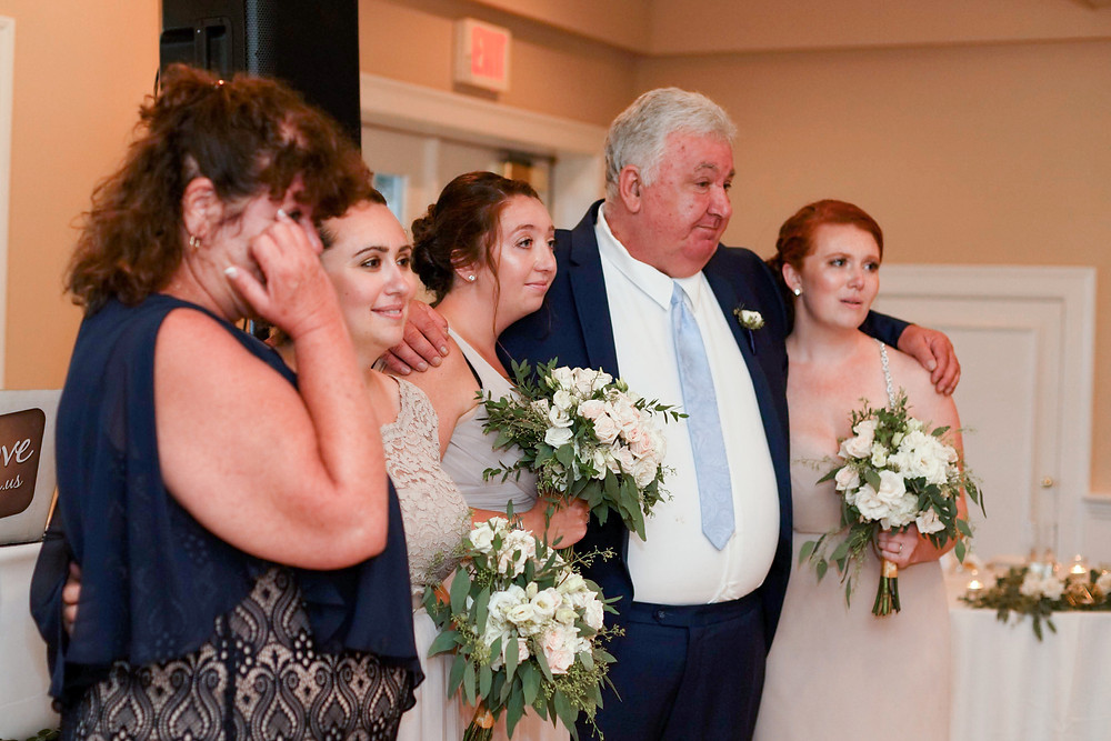 family crying during couple's first dance at brookside country club