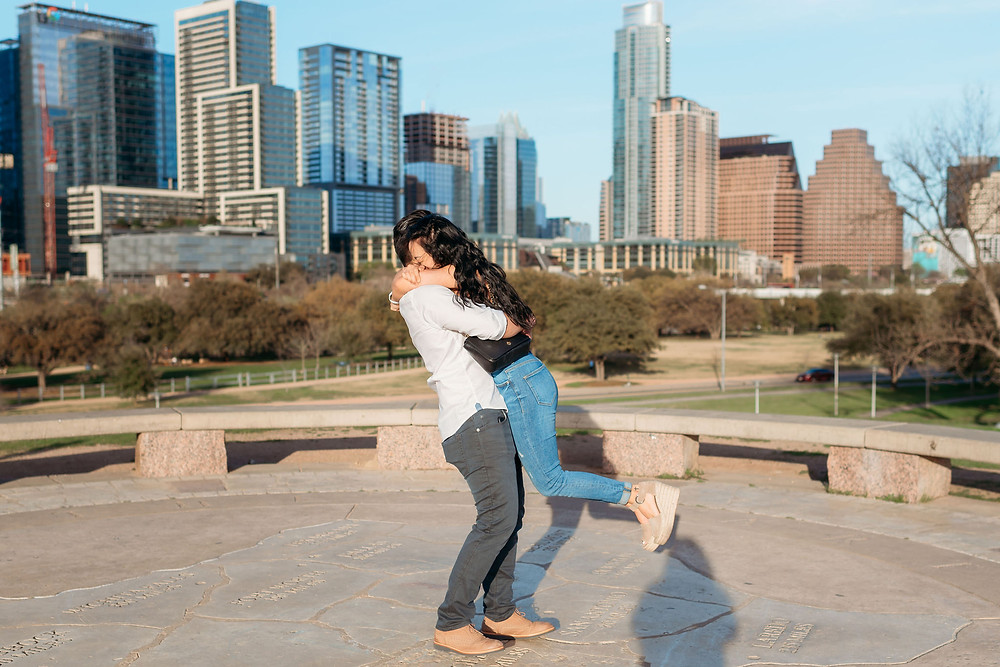 doug sahm hill downtown austin proposal. guy spins his new bride around after she says yes!