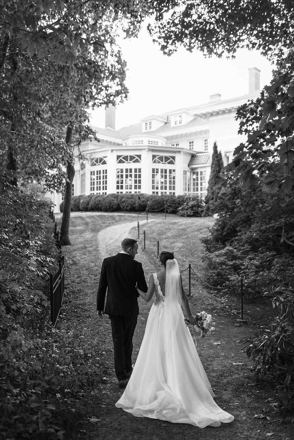 couple waking back to Tupper Manor through the woods