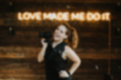 photograher with camera in front of the love made me do it sign at union on eighth bathroom