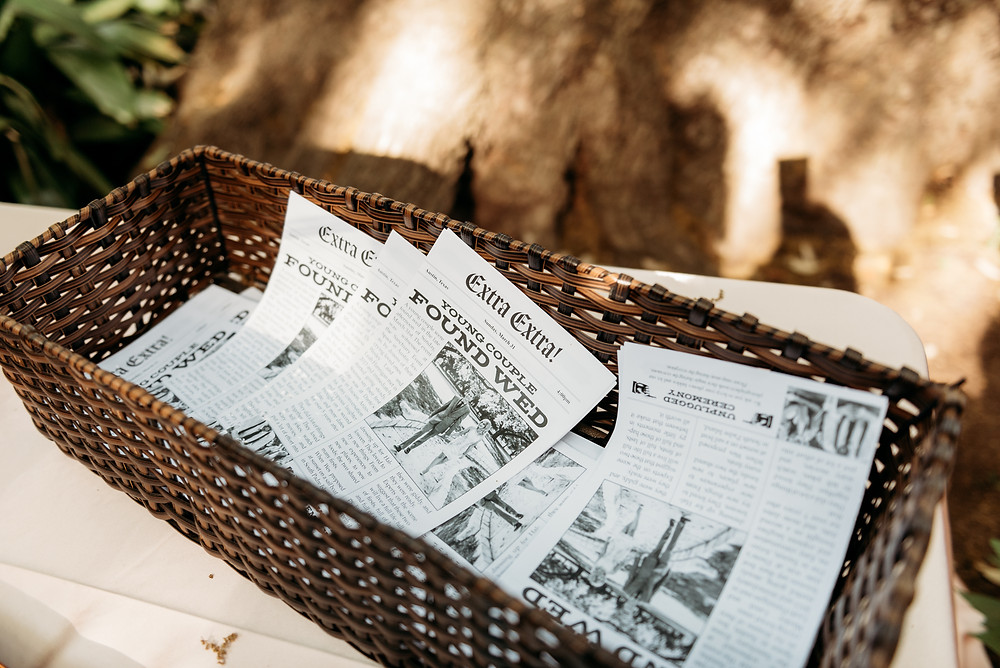 basket with wedding program in a newspaper theme