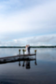 northern maine elopement on the coast. bride and groom stand at the end of a boat dock.