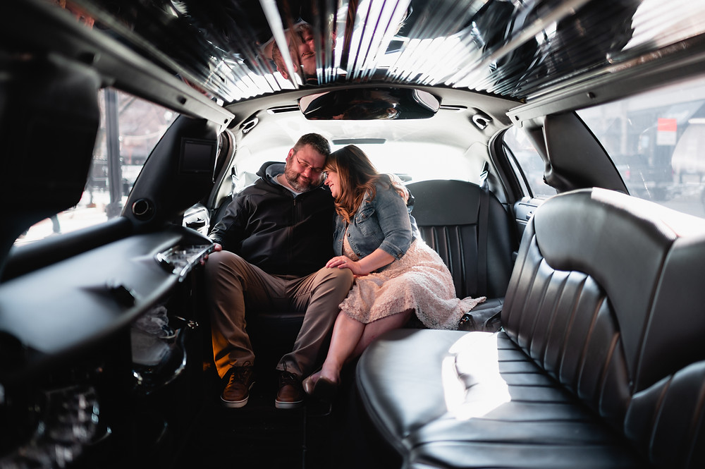 couple snuggling in limo after elopement