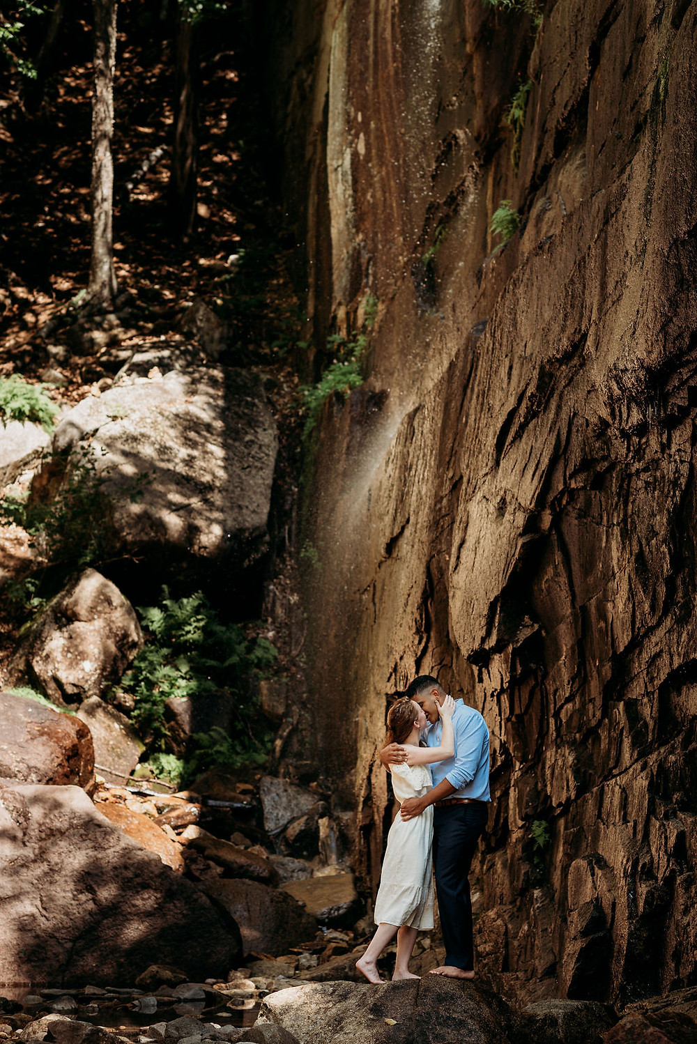 bride and groom by Pitcher falls during the mount chocorua hike for their elopement. New Hampshire elopement photographer