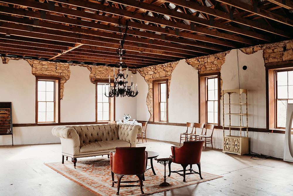 EM carriage house. interior venue with a vintage, rustic vibe.