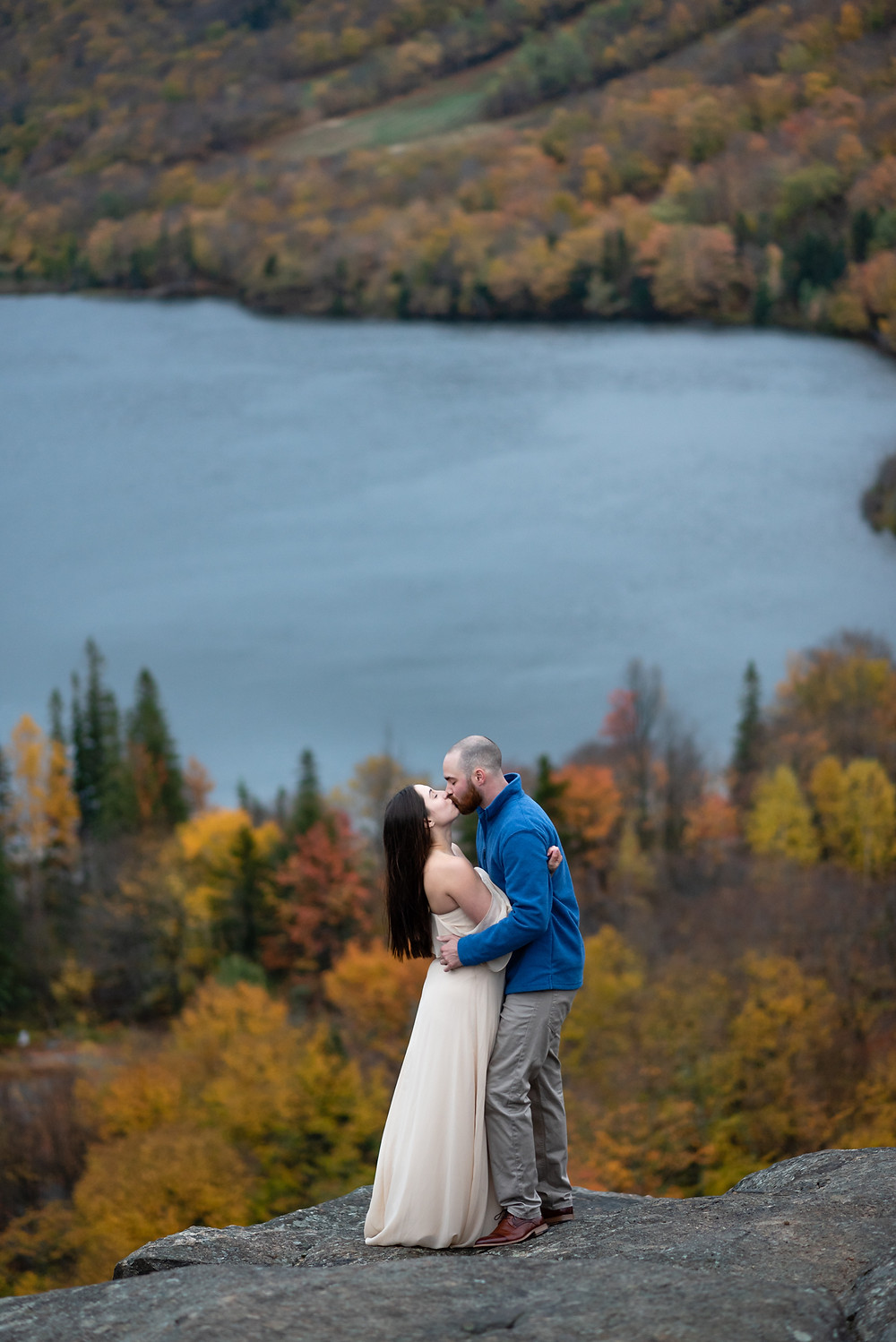 couple's first kiss for their adventure elopement at artists bluff in new hampshire