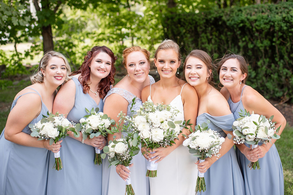 bridal party smiling at camera