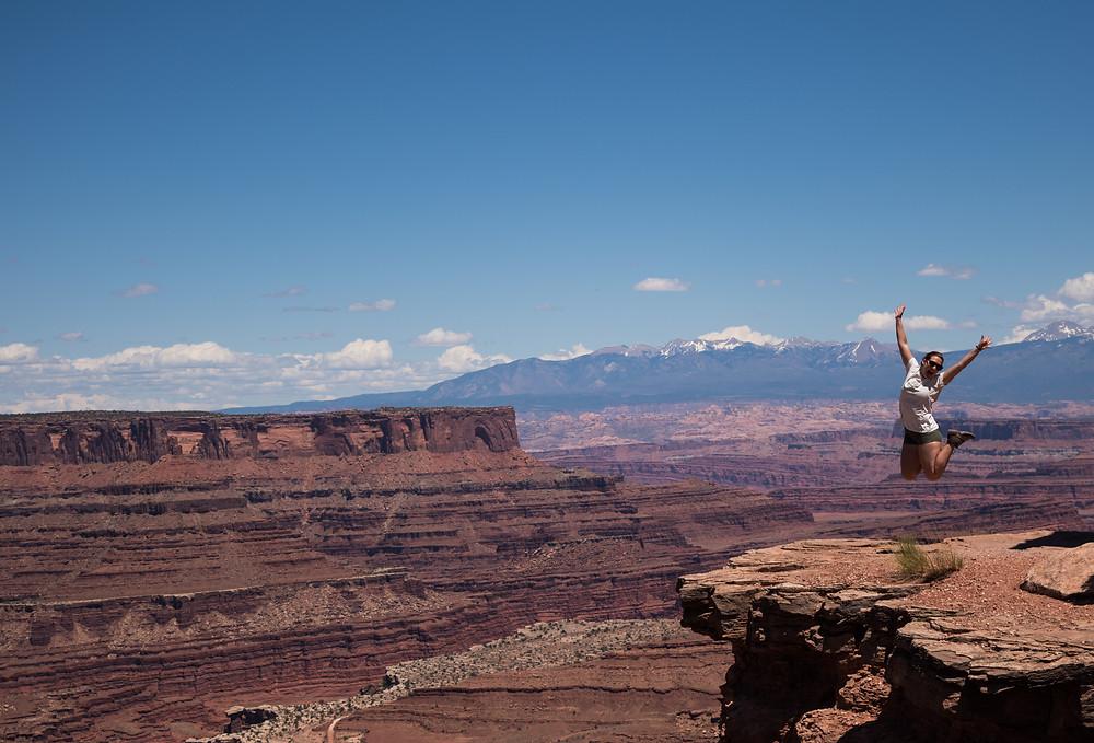 jumping photo at shafer canyon at canyonlands national park in utah