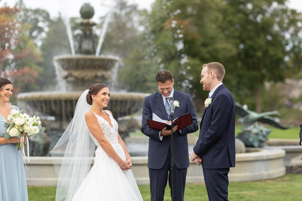 wedding ceremony on front lawn of tupper manor in front of the fountain