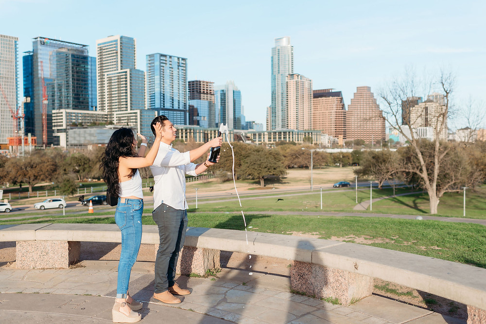 doug sahm hill downtown austin proposal. couple pops champagne after she says yes!