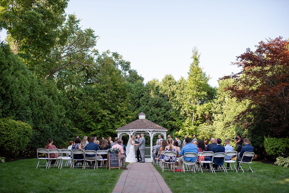 wide angle shot of ceremony at chocksett inn in the garden