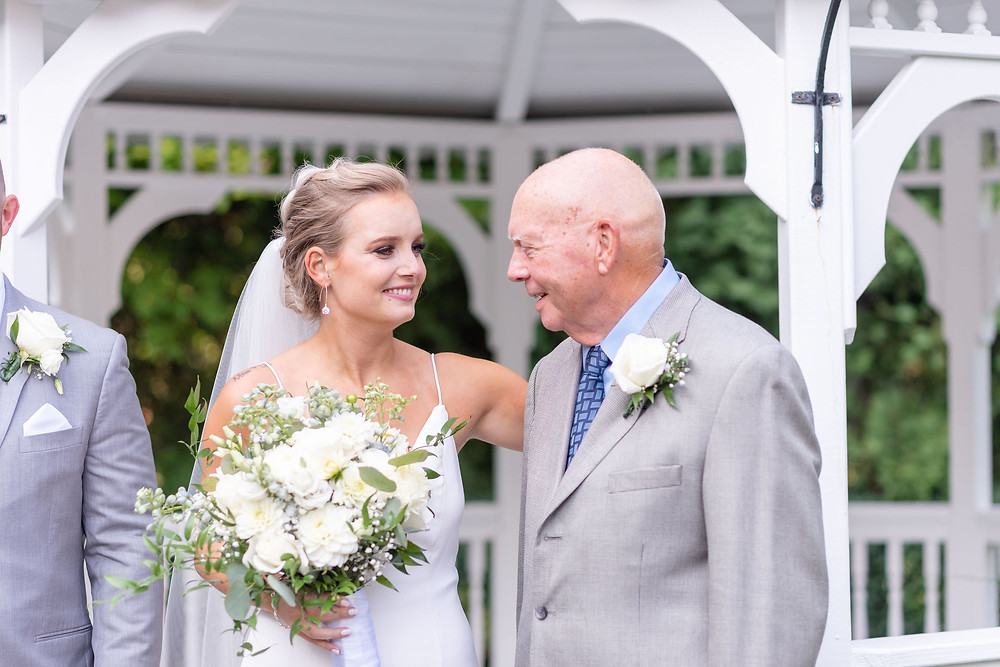 candid moment between bride and her grandfather