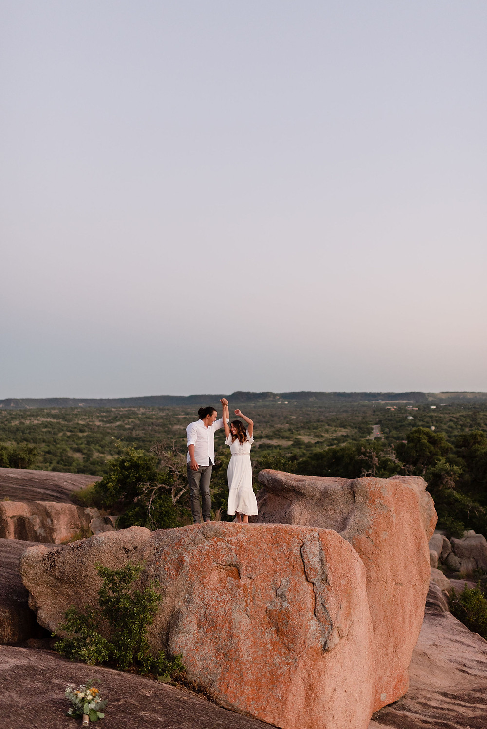 couple's first dance during elopement at enchanted rock