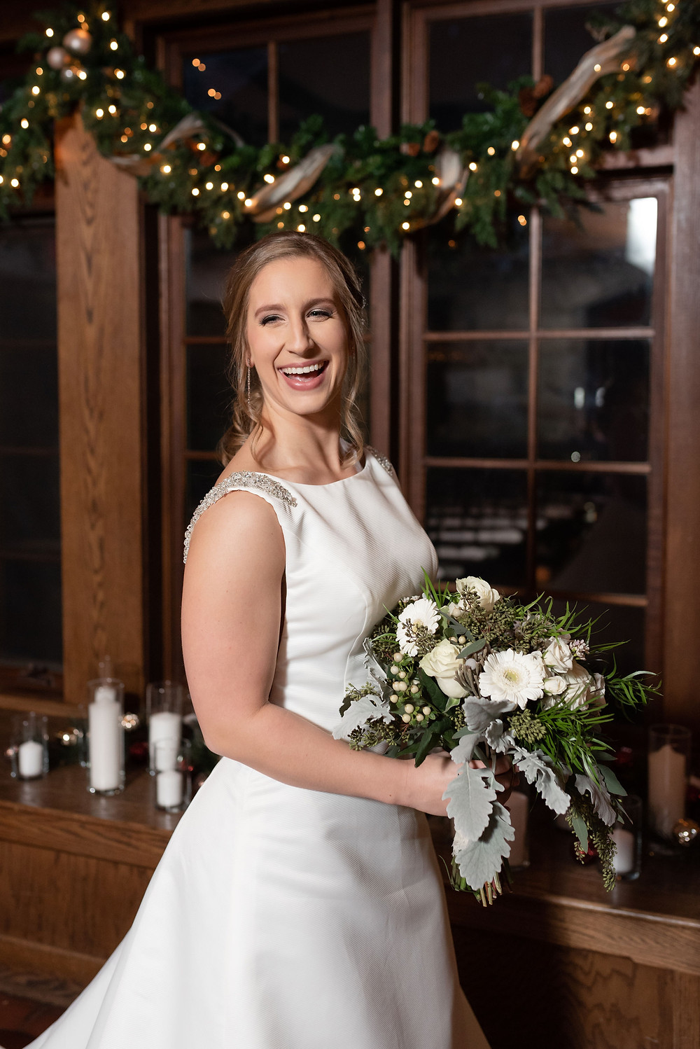 bridal portrait. bride smiling really big. flash photography is used since it is a winter wedding and it gets dark early