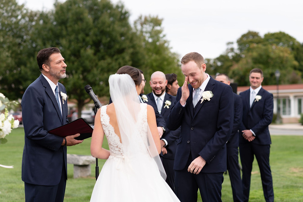 groom crying after seeing bride at ceremony