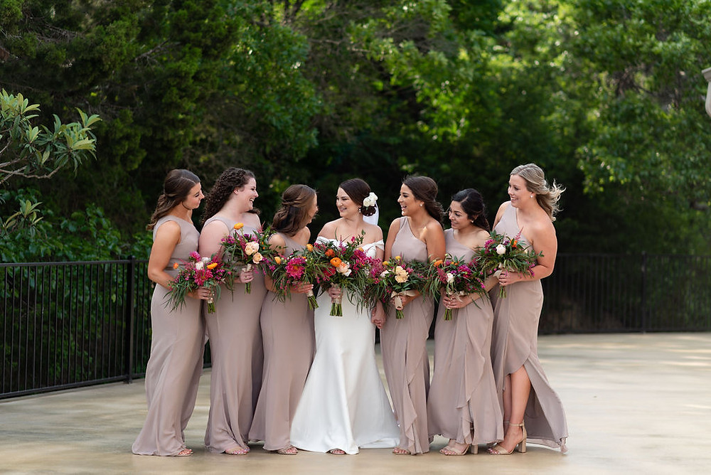 bride and bridesmaids laughing on terrace of villa antonia