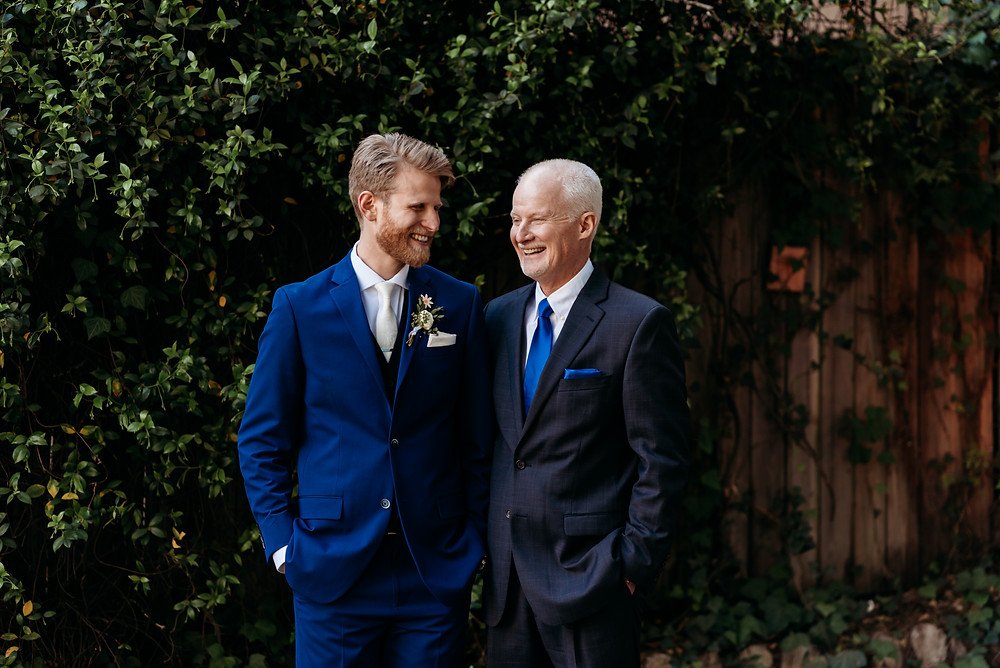 groom and dad laughing
