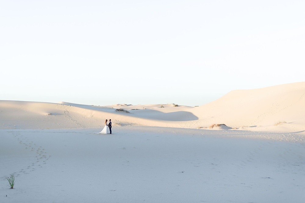 wide angle photo showing Monahans Sandhills landscape with the couple relatively small in frame