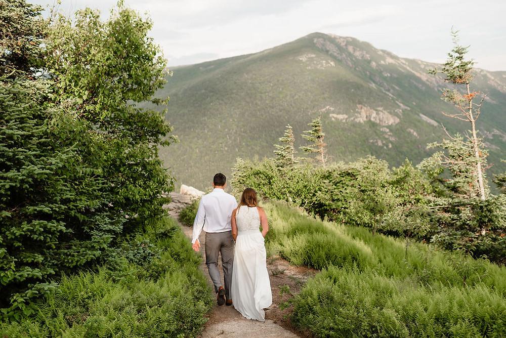 couple exploring the summit of mount willard.