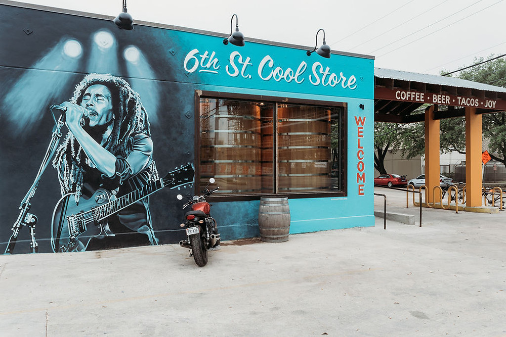 """Elopement at Lazarus brewery in Austin. Outside of Lazarus Brewery showing the bob marley mural on 6th street and """"coffee, beer, tacos, joy"""""""