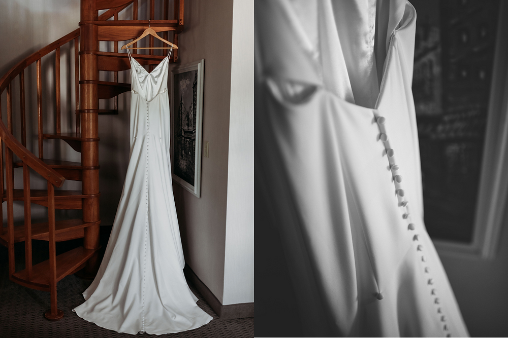 wedding dress photo hung up and shows details of buttons on back of dress